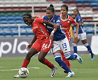 CALI - COLOMBIA, 14-09-2019: Elizabeth Carabali del América disputa el balón con Karen Paez de Millonarios durante partido por la semifinal vuelta de la Liga Femenina Aguila 2019 entre América de Cali y Millonarios jugado en el estadio Pascual Guerrero de la ciudad de Cali. / Elizabeth Carabali of America struggles the ball with Karen Paez of Millonarios during second leg match for the semifinals as part of Aguila Women League 2019 between America de Cali and Millonarios played at Pascual Guerrero stadium in Cali. Photo: VizzorImage / Gabriel Aponte / Staff