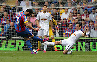 Pictured: Leon Britton of Swansea (R) stops a shot by Mile Jedinak of Crystal Palace<br />