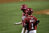 Arkansas Cayden Wallace (7) returns to the dugout following a score, Saturday, June 5, 2021 during the sixth inning in the second game of the NCAA Fayetteville Regional at Baum-Walker Stadium in Fayetteville. Check out nwaonline.com/210606Daily/ for today's photo gallery. <br /> (NWA Democrat-Gazette/Charlie Kaijo)