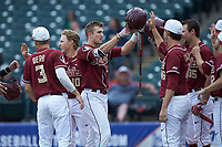 Jackson Lueck (2) of the Florida State Seminoles celebrates a home run with teammates against the Notre Dame Fighting Irish in Game Four of the 2017 ACC Baseball Championship at Louisville Slugger Field on May 24, 2017 in Louisville, Kentucky. The Seminoles walked-off the Fighting Irish 5-3 in 12 innings. (Brian Westerholt/Four Seam Images)