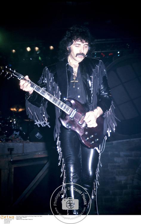 Tony Iommi of Black Sabbath performing on stage in the 1990's<br />© Dave Plastik / RetnaLtd<br />Credit all uses