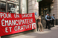 Montreal (QC) CANADA - March 21, 2012 - Students on strike walk on Notre-Dame street and occupy the street in front of the Quebec Minister of Cultural Affairs, Commmunications and feminine issues office on Saint-Laurent Boulevard.