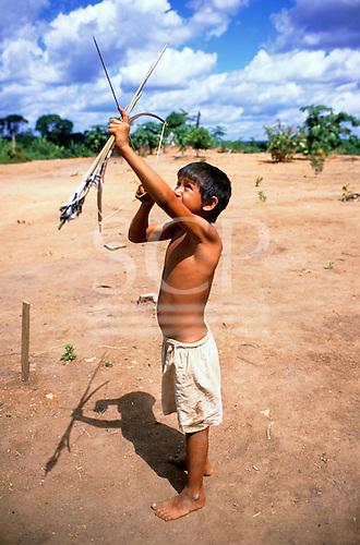 Ipixuna village, Amazon, Brazil. Arawete boy with bow and arrow.
