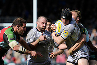 George Skivington of Leicester Tigers is tackled by Chris Robshaw of Harlequins as George Chuter of Leicester Tigers looks on during the Aviva Premiership match between Harlequins and Leicester Tigers at The Twickenham Stoop on Saturday 21st April 2012 (Photo by Rob Munro)