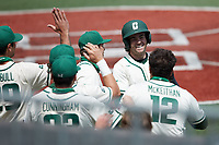 Austin Knight (14) of the Charlotte 49ers is congratulated by his teammates after scoring a run during the game against the Old Dominion Monarchs at Hayes Stadium on April 25, 2021 in Charlotte, North Carolina. (Brian Westerholt/Four Seam Images)