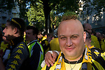 In Dortmund fans celebrated a gigantic party because of the title win of their favorite soccer club BVB 09 in the German Premium League. Here a fan presents his trophy, a piece of the turf, on his baldness.