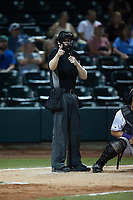 Home plate umpire Mitch Leikam makes a strike call during the game between the Hickory Crawdads and the Winston-Salem Dash at Truist Stadium on July 10, 2021 in Winston-Salem, North Carolina. (Brian Westerholt/Four Seam Images)