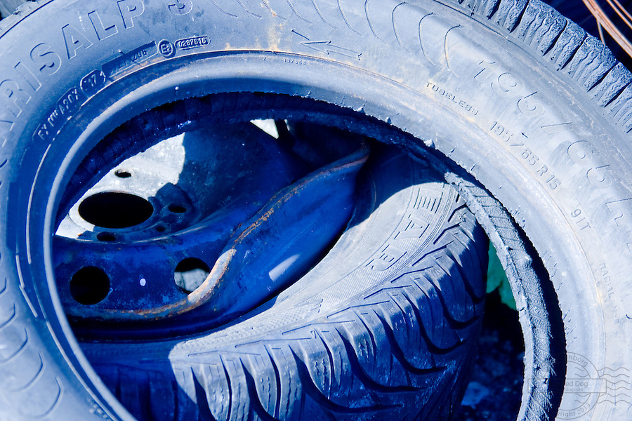 Closeup of tires, with at blue tint.