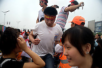 Spectators rush to keep up with the Olympic torch runners during the Nanjing, China, leg of the 2008 Olympic Torch Relay.