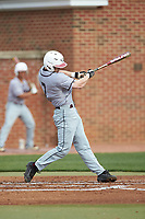 Corey Joyce (7) of the North Carolina Central Eagles follows through on his swing against the High Point Panthers at Williard Stadium on February 28, 2017 in High Point, North Carolina. The Eagles defeated the Panthers 11-5. (Brian Westerholt/Four Seam Images)