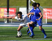 NWA Democrat-Gazette/CHARLIE KAIJO Bentonville High School Elliott Nimrod (9) fights for possession as Rogers High School defender Dante Pardetti (3) covers during a soccer game, Friday, April 26, 2019 at  Whitey Smith Stadium at Rogers High School in Rogers.