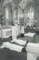 1990 FILE PHOTO - ARCHIVES -<br /> <br /> New Priests: Toronto Archbishop Aloysius Ambrozic ordains new priests last spring. The Toronto archdiocese has no parishes without priests, but some 150 congregations in Canada - mainly in Quebec - have no pastor.<br /> <br /> <br /> <br /> 1990<br /> <br /> PHOTO : Boris Spremo - Toronto Star Archives - AQP