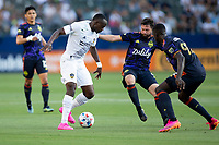 CARSON, CA - JUNE 19: Sega Coulibaly #4 of the Los Angeles Galaxy turns with the ball during a game between Seattle Sounders FC and Los Angeles Galaxy at Dignity Health Sports Park on June 19, 2021 in Carson, California.