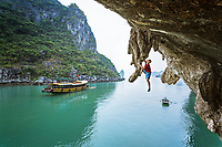 Neil Gresham, the Deep Water Soloing (DWS) pioneer, and one of the world's best all round climbers high above Ha Long Bay, Vietnam<br /> Unnamed route - 6c+