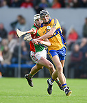 Shane Golden of Sixmilebridge in action against Cillian Duggan of Clooney-Quin during their senior county final replay at Cusack park. Photograph by John Kelly.