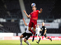 12th September 2020; Pride Park, Derby, East Midlands; English Championship Football, Derby County versus Reading; Michael Morrison of Reading climbs above Jack Marriott of Derby County to head the ball