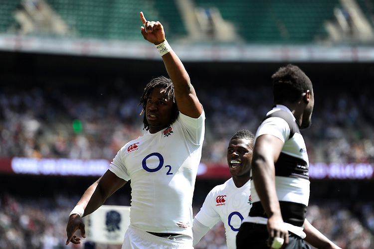 Marland Yarde of England celebrates scoring a try during the match between England and Barbarians at Twickenham on Sunday 26th May 2013 (Photo by Rob Munro)