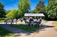 High Wycombe, England. 19 May 2020<br /> .<br /> People social distancing in a park in High Wycombe enjoy the sun as the park cafe opens during the current lockdown with new guidelines issued by the government at The Rye, Park, Bucks, England on 19 May 2020. Photo by Andy Rowland.
