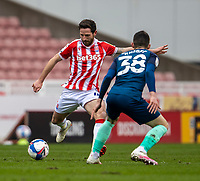 20th March 2021; Bet365 Stadium, Stoke, Staffordshire, England; English Football League Championship Football, Stoke City versus Derby County; Joe Allen of Stoke City passes the ball past Jason Knight of Derby County