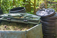 Mowed grass in compost bins in the garden at Kirk House, Chipping, Preston, Lancashire.