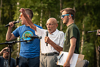 Alaska's last surviving Constitutional delegate, Vic Fischer, speaks at a rally to override the governor's vetoes of the budget featuring Grammy-winning Alaska rock band Portugal. The Man at the Alaska Airlines Center.