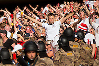 Riot police have to wade in to calm down a section of England fans
