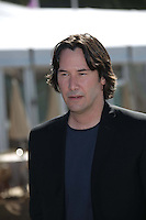 """Actor / director Keanu Reeves poses at the photocall of """"Man Of Tai Chi"""" during the the 66th Cannes International Film Festival at Hotel Carlton Pier in Cannes, France, on 20 May 2013."""
