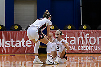 SANTA CRUZ, CA - JANUARY 22: Lexie Hull #12 helps up her sister Lacie Hull #24 during the Stanford Cardinal women's basketball game vs the UCLA Bruins at Kaiser Arena on January 22, 2021 in Santa Cruz, California.