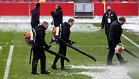 Brentford ground staff clear the goalmouths of snow ahead of kick-off during Brentford vs Leicester City, Emirates FA Cup Football at the Brentford Community Stadium on 24th January 2021