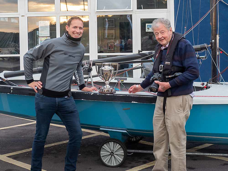 National 18 Class Captain Charles Dwyer (left) presents Bob Bateman with the Michael Sullivan Trophy for his exceptional support of the dinghy class