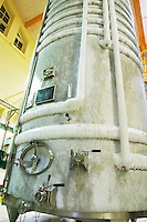 A stainless steel fermentation tank with still wine undergoing cold stabilization. the tank is covered with ice since the wine can be chilled down to four degrees below freezing point at Champagne Deutz in Ay, Vallee de la Marne, Champagne, Marne, Ardennes, France