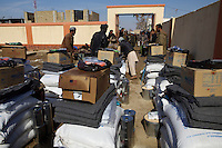 UNVs distributing food and non food items to IDPs in Shebargan, North Afghanistan