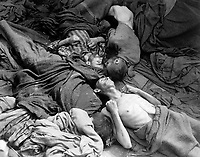 Starved bodies of prisoners who were transported to Dachau from another concentration camp, lie grotesquely as they died enroute.  This is contents of one of 50 similar freight cars.  Germany, April 30, 1945.  T4c. Sidney Blau.  (Army)<br /> NARA FILE #:  111-SC-264811<br /> WAR & CONFLICT BOOK #:  1118