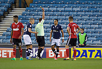 James Meredith of Millwall is shown the yellow card by Referee James Linington for diving during the Sky Bet Championship match between Millwall and Ipswich Town at The Den, London, England on 15 August 2017. Photo by Alan  Stanford / PRiME Media Images.