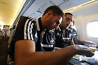 Wednesday 07 August 2013<br /> Pictured L-R: Angel Rangel and Chico Flores playing a board game on an iPad en route to Malmo.<br /> Re: Swansea City FC travelling to Sweden for their Europa League 3rd Qualifying Round, Second Leg game against Malmo.