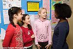 Education Elementary School Grade 5 group of 4 girls talking in hallway