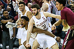 Florida State forward Malik Osborne (10) and forward Wyatt Wilkes (31) react to a dunk late in the second half of an NCAA college basketball game against Louisville in Tallahassee, Fla., Monday, Feb. 24, 2020. Florida State defeated Louisville 82-67.  (AP Photo/Mark Wallheiser)