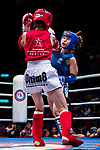 Jumpo Yurika (Red) of Japan fights against Kwok How Ling (Blue) of Hong Kong in the female muay 48KG division weight bout during the East Asian Muaythai Championships 2017 at the Queen Elizabeth Stadium on 13 August 2017, in Hong Kong, China. Photo by Yu Chun Christopher Wong / Power Sport Images