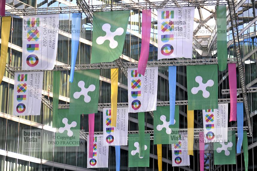 - Milano, bandiere dell'Expo 2015 nel palazzo della Regione Lombardia<br /> <br /> - Milan Expo 2015 flags in the building of the Lombardy Region