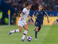 PARIS,  - JUNE 28: Alex Morgan #13 holds the ball during a game between France and USWNT at Parc des Princes on June 28, 2019 in Paris, France.