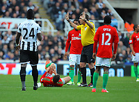 Saturday 17 November 2012<br /> Pictured: Itay Shechter of Swansea referee Phil Dowd, Cheick Tiote Nathan Dyer, Jonathan de Guzman<br /> Re: Barclay's Premier League, Newcastle United v Swansea City FC at St James' Park, Newcastle Upon Tyne, UK.