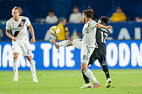 CARSON, CA - SEPTEMBER 15: Jonathan dos Santos #8 of the Los Angeles Galaxy and Gerso #12 of Sporting Kansas City battle for a loose ball during a game between Sporting Kansas City and Los Angeles Galaxy at Dignity Health Sports Complex on September 15, 2019 in Carson, California.