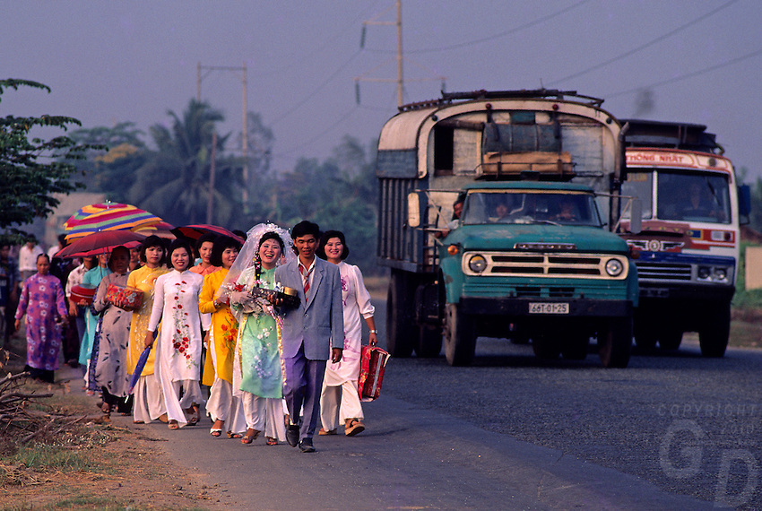 """1992 -A traditional Wedding circa 1992 near Can Tho, the hub of the Mekong Delta (Vietnamese: Đồng bằng Sông Cửu Long """"Nine Dragon river delta""""), also known as the Western Region (Vietnamese: Miền Tây or the South-western region (Vietnamese: Tây Nam Bộ) is the region in southwestern Vietnam where the Mekong River approaches and empties into the sea through a network of distributaries. The Mekong delta region encompasses a large portion of southwestern Vietnam of 39,000 square kilometres (15,000sqmi). The size of the area covered by water depends on the season.<br /> The Mekong Delta has been dubbed as a """"biological treasure trove"""". Over 1,000 animal species were recorded between 1997 and 2007 and new species of plants, fish, lizards, and mammals has been discovered in previously unexplored areas, including the Laotian rock rat, thought to be extinct."""
