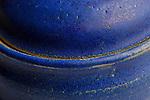 Hand made Blue Pottery Keepsake Jar with unusual similing lid appearance.