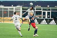 FOXBOROUGH, MA - APRIL 17: Ivan Magalhaes #4 of Richmond Kickers leaps for the high ball during a game between Richmond Kickers and Revolution II at Gillette Stadium on April 17, 2021 in Foxborough, Massachusetts.