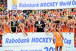 The Hague, Netherlands, June 14: Maartje Paumen #17 of The Netherlands gets the World Cup Trophy during the winners ceremony after the field hockey gold medal match (Women) between Australia and The Netherlands on June 14, 2014 during the World Cup 2014 at Kyocera Stadium in The Hague, Netherlands. Final score 2-0 (2-0)  (Photo by Dirk Markgraf / www.265-images.com) *** Local caption ***