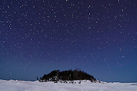 A view of Little Presque Isle on clear winter night. Marquette, MI