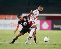 Andy Najar (14) of D.C. United tries to take the ball away from Thierry Henry (14) of the New York Red Bulls during the game at RFK Stadium in Washington, DC.  D.C. United tied the New York Red Bulls, 2-2.