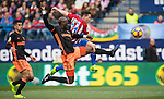Kevin Gameiro of Atletico de Madrid (right) competes for the ball with  Eliaquim Hans Mangala of Valencia CF (center) and his teammate Joao Cancelo (left) during the match Atletico de Madrid vs Valencia CF, a La Liga match at the Estadio Vicente Calderon on 05 March 2017 in Madrid, Spain. Photo by Diego Gonzalez Souto / Power Sport Images