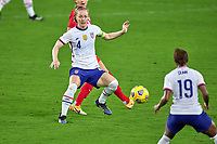 18th February 2021, Orlando, Florida, USA;  United States defender Becky Sauerbrunn (4) passes the ball to United States defender Crystal Dunn during a SheBelieves Cup game between Canada and the United States on February 18, 2021 at Exploria Stadium in Orlando, FL.